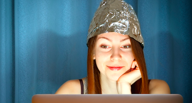 Woman-wearing-tinfoil-hat-looking-at-computer-Shutterstock-800x430.png
